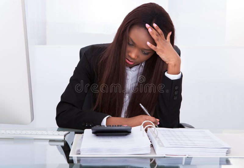 Tensed young businesswoman stock image