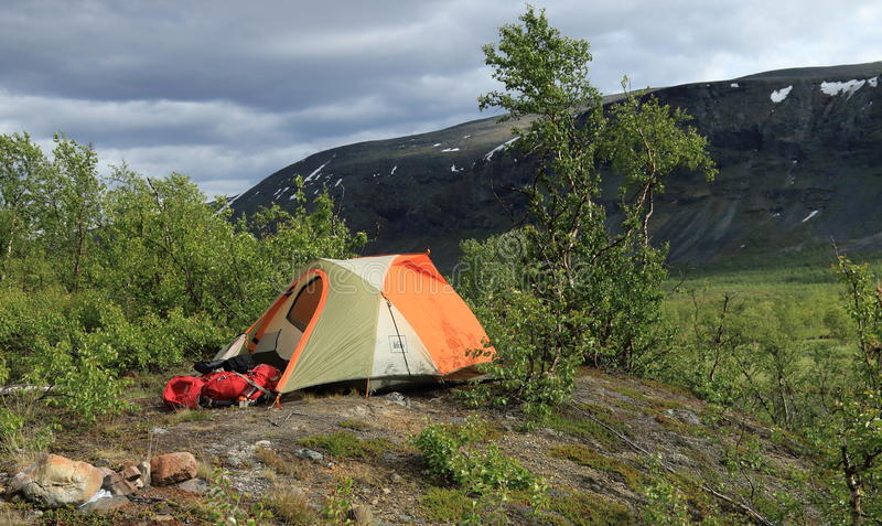 Tent and camping equipment on the Kungsleden trail in Sweden. royalty free stock photography