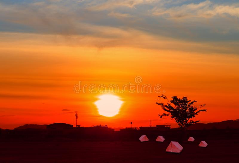 Tent canvas tourist accommodation camping relax time sunset on background with copy space stock photos