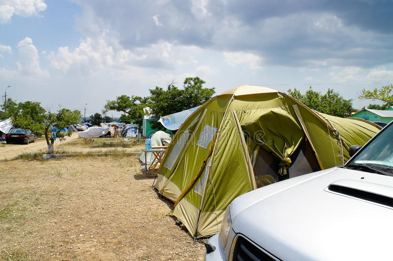 Tent car camping. On a background of sky and mountains royalty free stock image