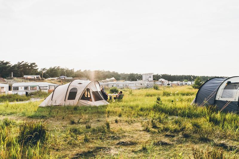 Tent & caravans on a meadow royalty free stock photos