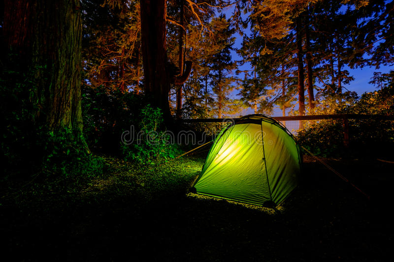 Tent in the forest stock photo