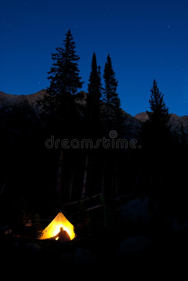 Tent Glowing in the Wilderness Camping Backpacking Adventure royalty free stock images