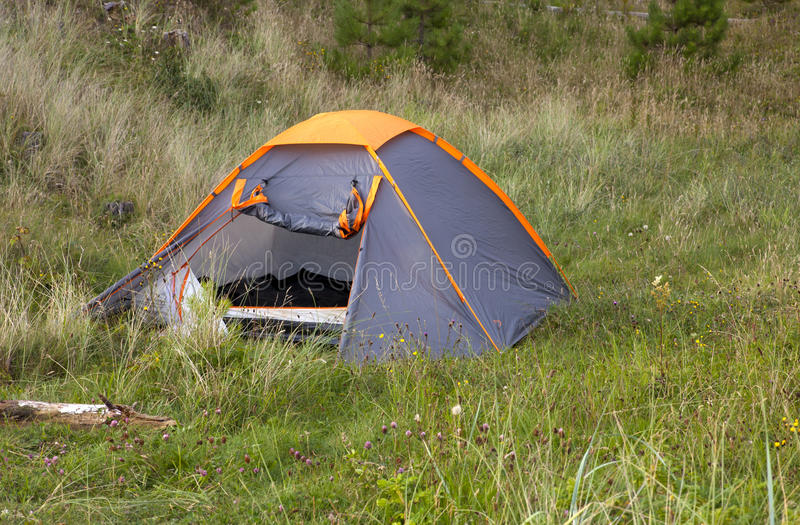 Download Tent on grassland stock photo. Image of camp, tree, vacation - 26269532