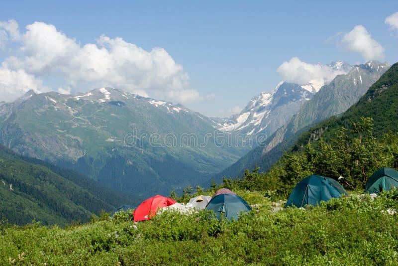 Tent in high mountain stock photos