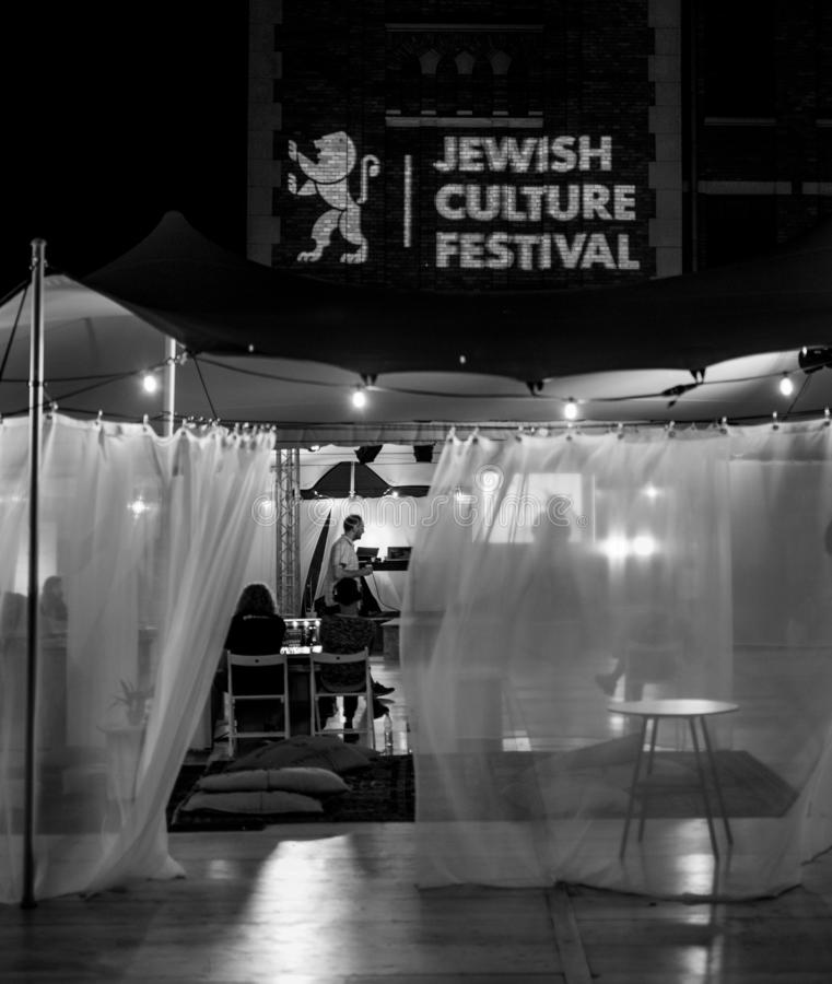 Tent at the Jewish Culture Festival, hosted annually in Kazimierz, the historic Jewish Quarter of Krakow, Poland. Photographed at night in monochrome royalty free stock images