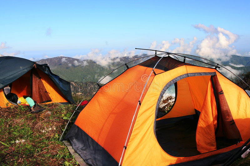 Tent in mountain stock photography