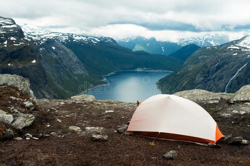 Tent on mountain cliff. Edge trolltunga stock photo