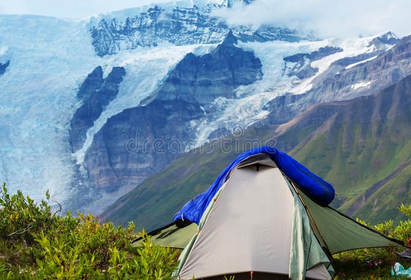 Tent in mountains royalty free stock photo