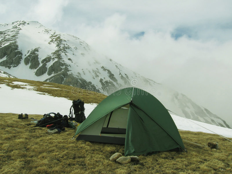 Tent in mountains royalty free stock image