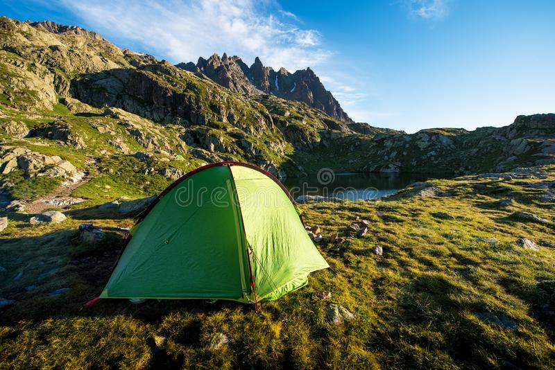 Tent in the mountains in the Alps, Europe still life coach, company, friendship, background - concept.  stock image
