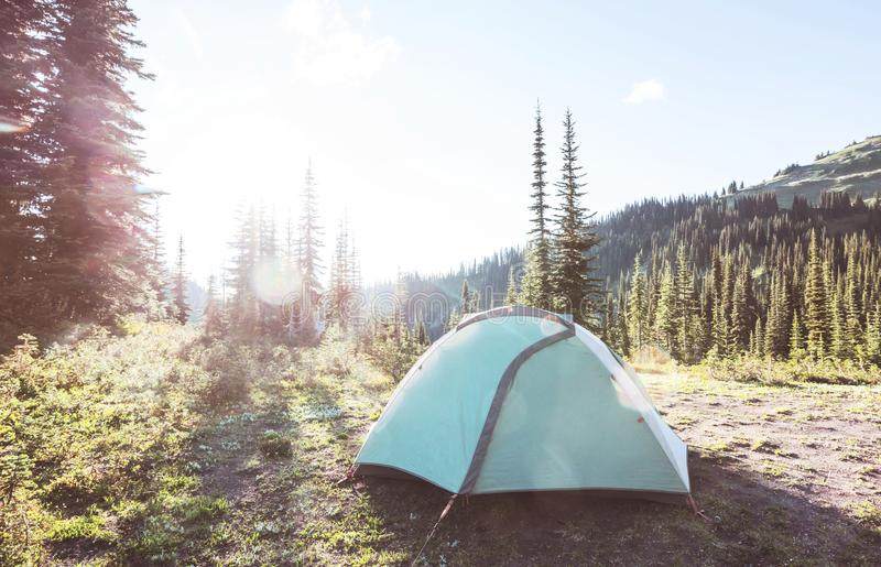 Tent in mountains stock images