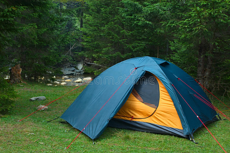 Tent at river bank stock images