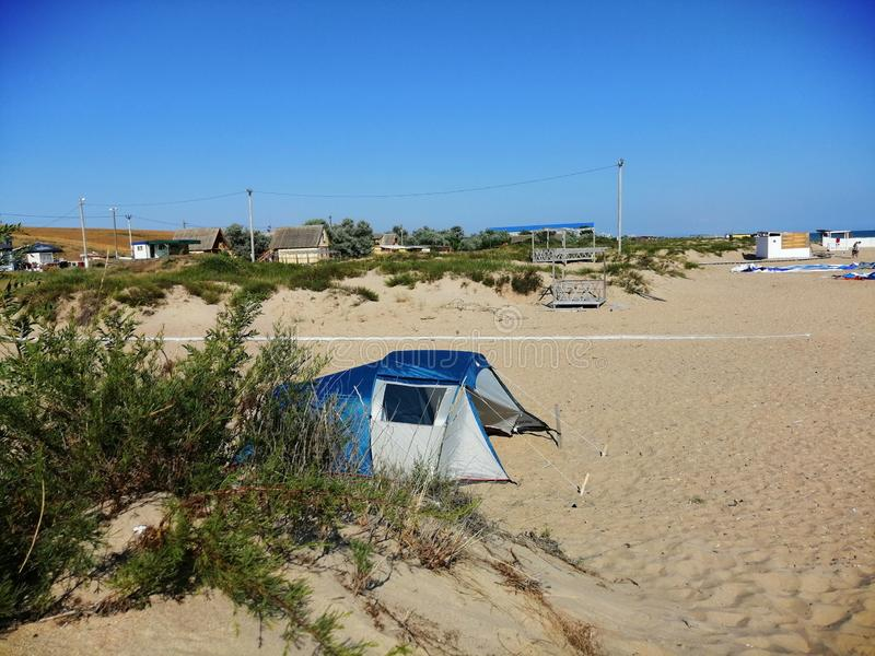 Tent on the sandy beach stock photos