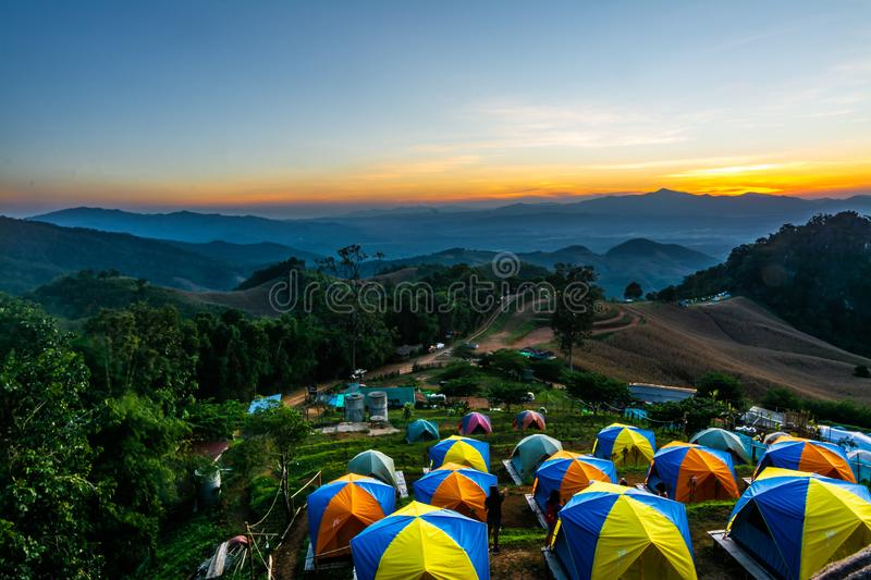 Tent in the sunset overlooking mountains royalty free stock photography