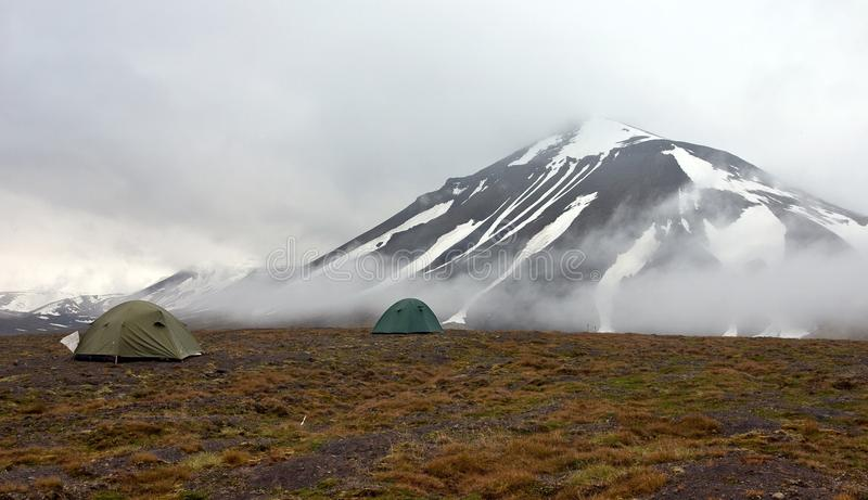 A Tent in Tundra in Svalbard. A Tent in Tundra in the Svalbard Archipelago in the Arctic. Cold and Wet Weather Reigns There Even in the Summer royalty free stock image