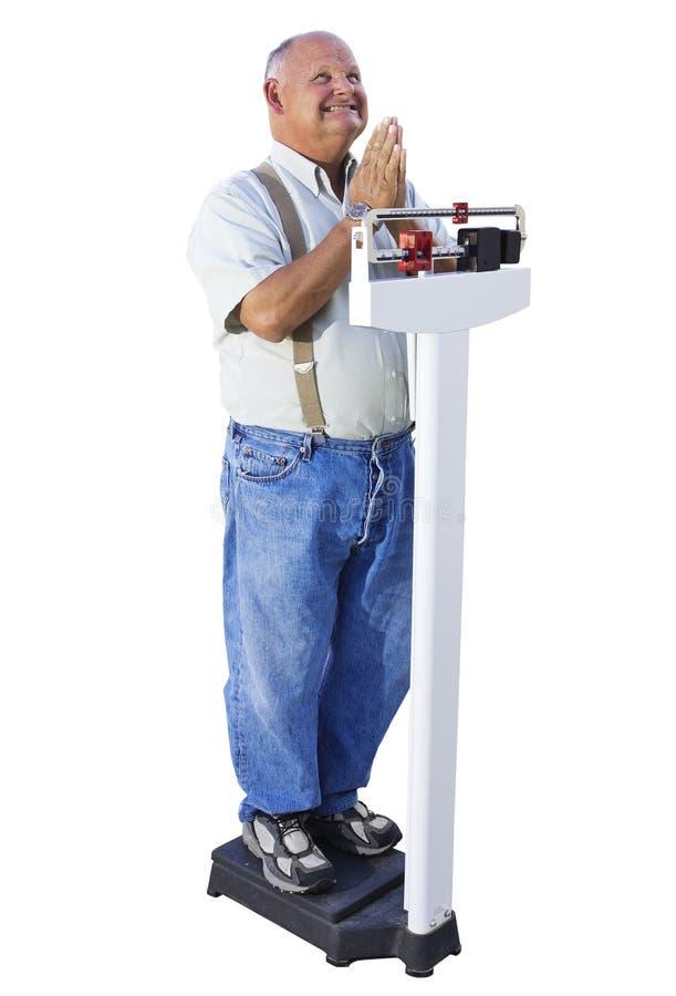 Tentativa masculina sênior perder o peso fotografia de stock