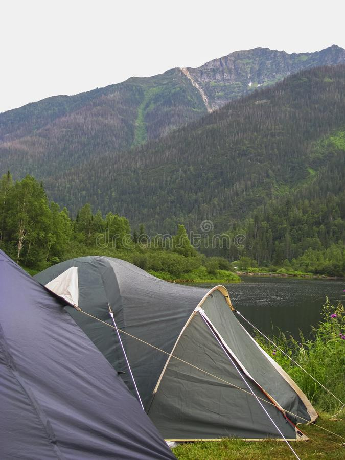 Tents on the bank of the lake stock photos