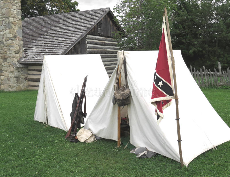 Civil War Tents : Tents and flag in a confederate camp stock photo image