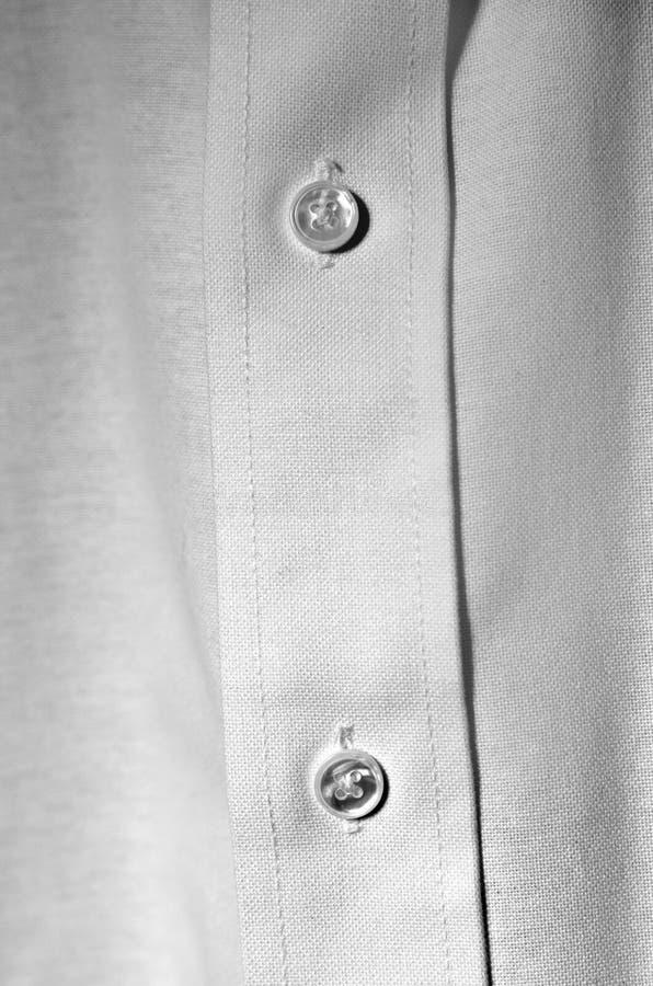 Tenue de soirée blanc d'affaires de boutons de chemise habillée photos stock