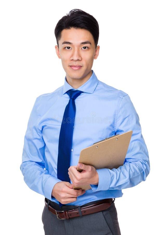 Download Tenuta Asiatica Dell'uomo D'affari Con L'archivio Immagine Stock - Immagine di archivio, lista: 55355681