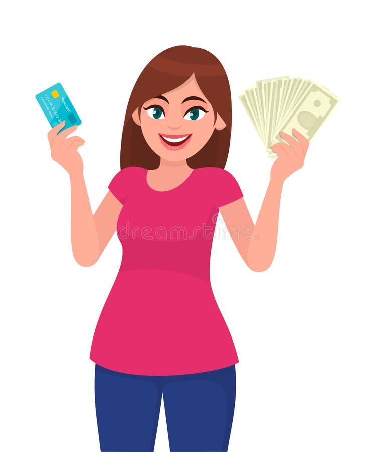 Tenuta attraente della giovane donna o mostrare un credito/carta di debito ed i contanti/soldi/note di valuta a disposizione Paga illustrazione di stock
