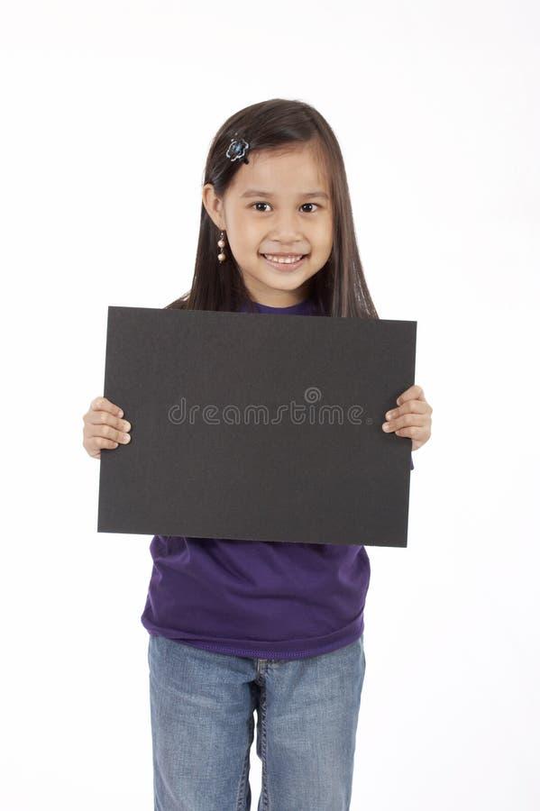 Tenuta del cartello fotografia stock