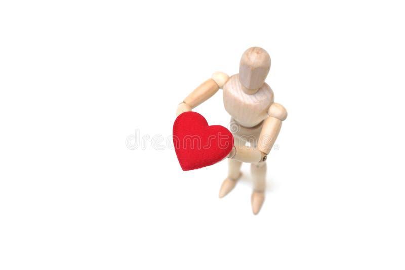 Tenuta del cuore rosso fotografia stock libera da diritti
