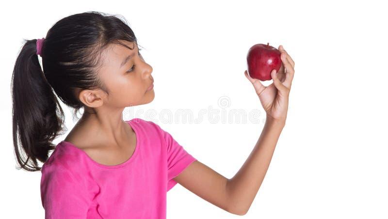 Tenuta dell'Apple rosso III fotografia stock libera da diritti