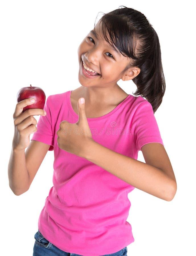Tenuta dell'Apple rosso VIII fotografie stock libere da diritti