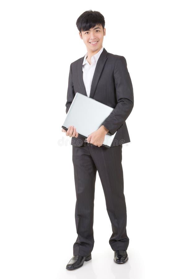 Tenuta dell'uomo d'affari un computer portatile immagini stock