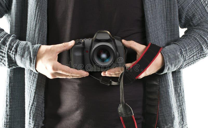 Macchina fotografica della tenuta DSLR dell'uomo fotografia stock libera da diritti