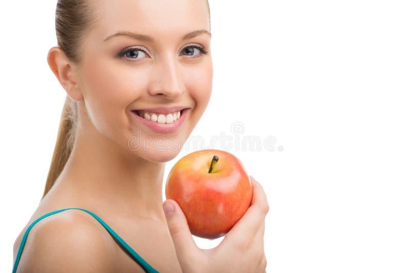 Tenuta della mela bella fotografia stock