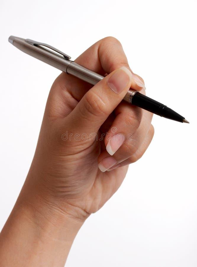 Tenuta della penna fotografie stock libere da diritti
