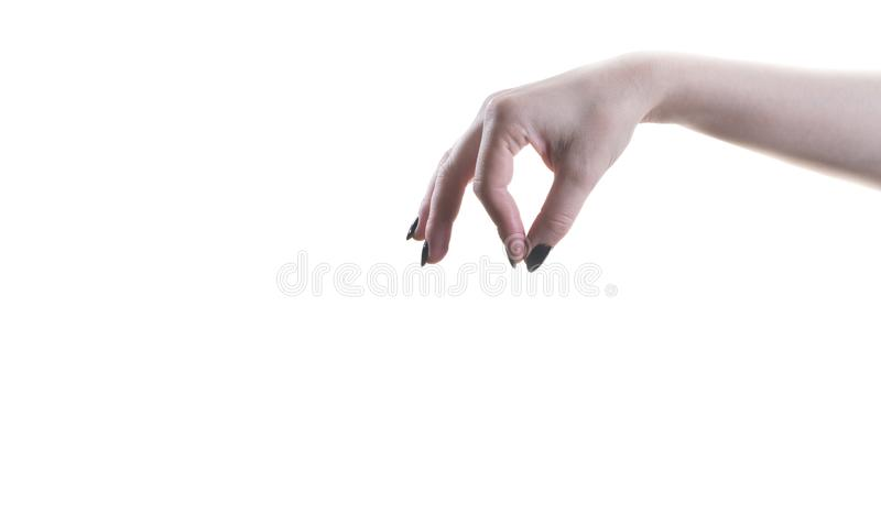 Tenuta femminile della mano qualcosa con due dita immagini stock
