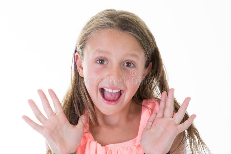 Tenuta spaventata della ragazza che grida fuori isolato alto fotografia stock libera da diritti