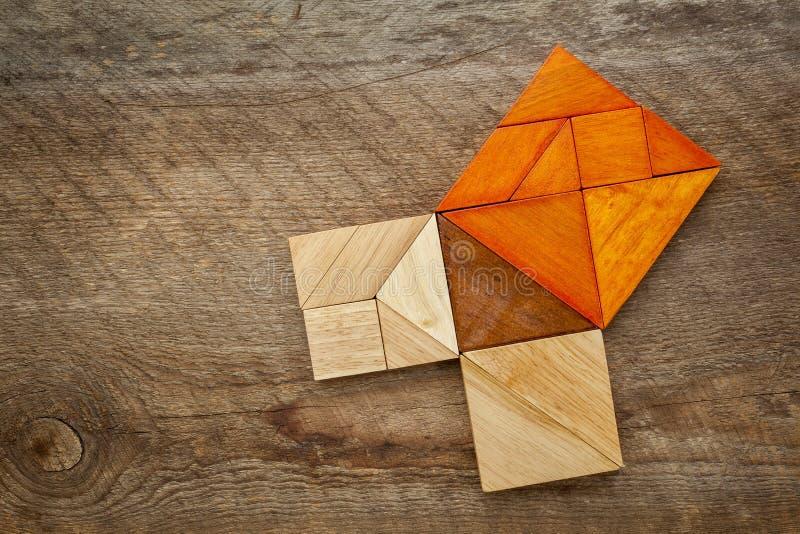 Teorema pitagorico nel puzzle del tangram immagini stock