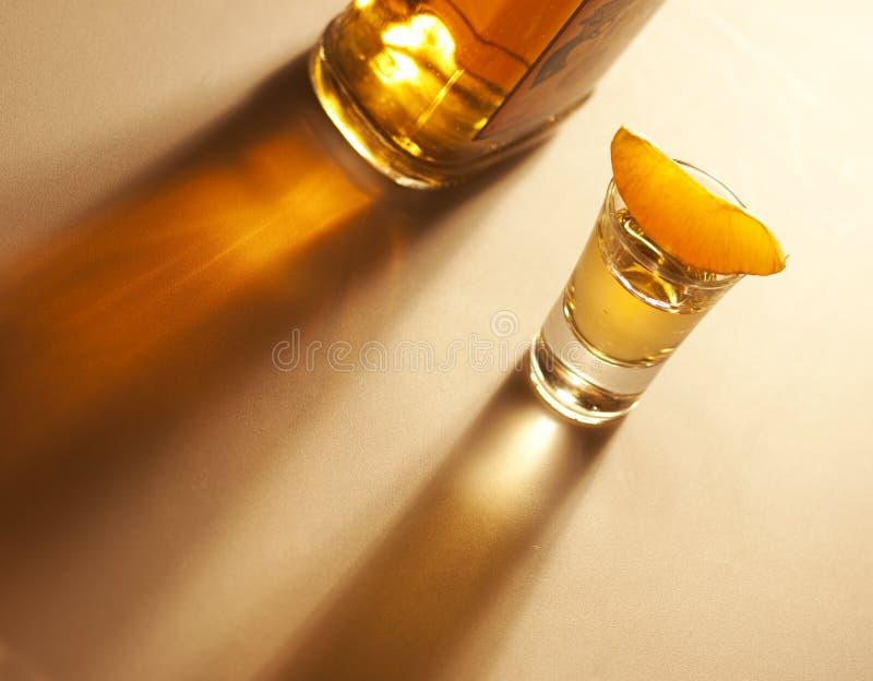 tequila съемки бутылки померанцовый стоковая фотография