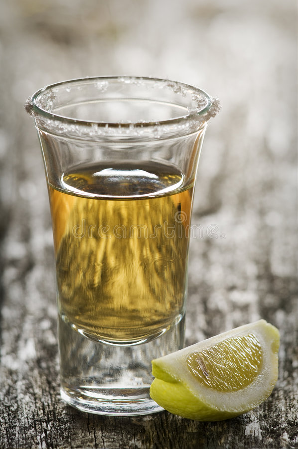 Tequila. Shot, with lemon and salt close up royalty free stock photo