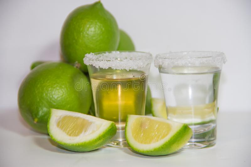 Tequila glasses typical drink of mexico with lemon and salt royalty free stock image