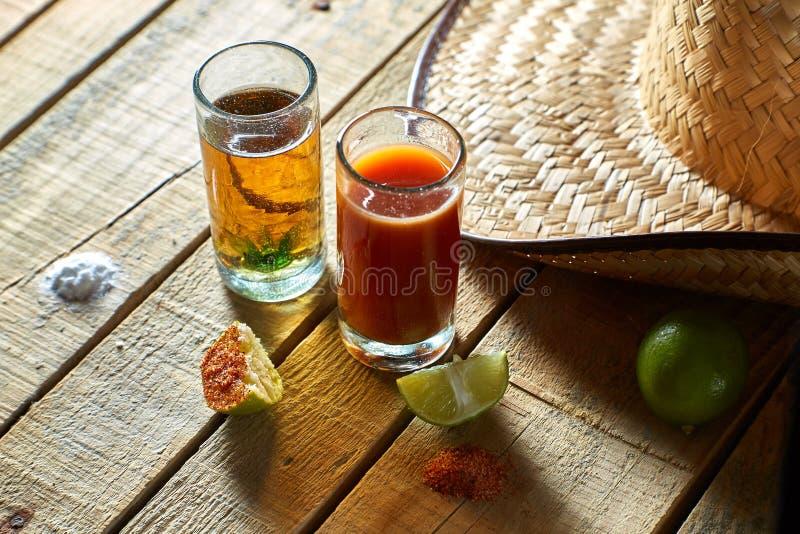 Tequila, sangrita y limón imagenes de archivo
