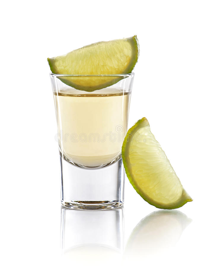 Tequila shot. A tequila shot with a slices of lime stock photo