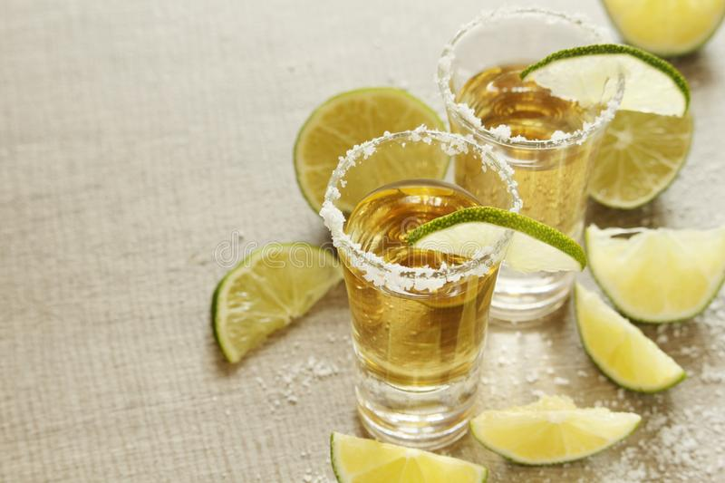 Tequila shots with lime stock image
