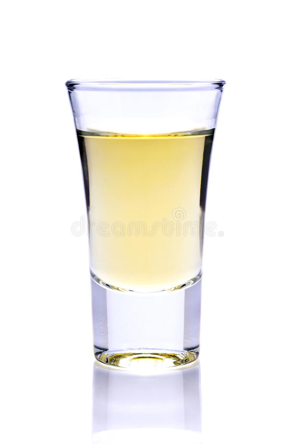Tequila or whiskey shot. Shot of tequila or whiskey isolated on a white background royalty free stock photo