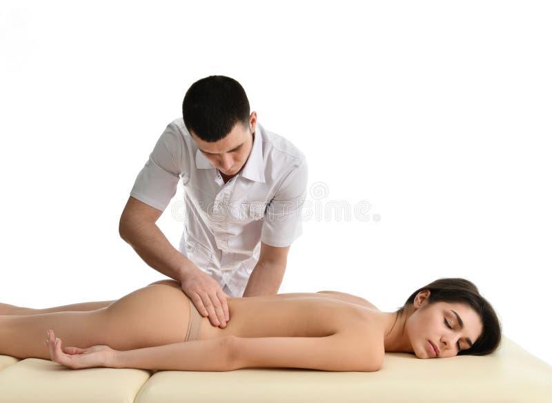 Terapeuta lekarka egzamininuje jego cierpliwego żołądek masować odosobnionego lub robi podbrzuszu na bielu obraz royalty free