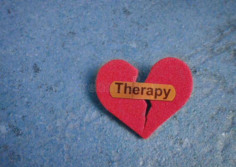Terapi förbinder på hjärta arkivfoton