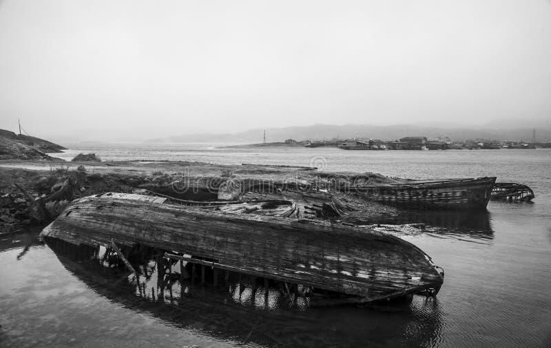 Teriberka, Murmansk Region, Russia. Ships graveyard in the water of the Barents Sea, Teriberka, Russia royalty free stock photography