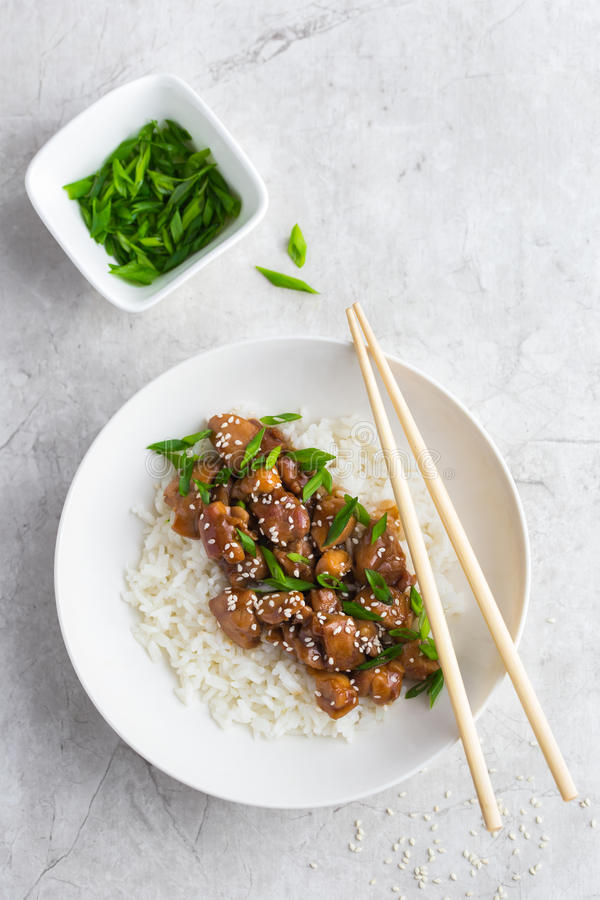 Teriyaki chicken with rice, served with sesame seeds and chopped. Green onions, top view stock photography