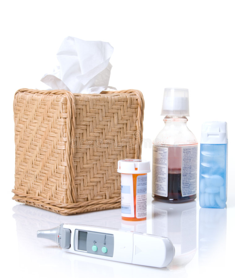 Termómetro con gripe y remedios fríos imagen de archivo