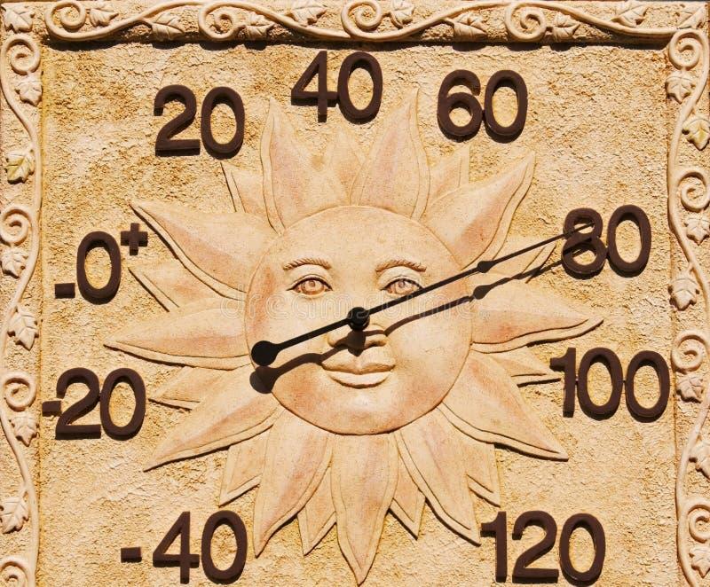 Termômetro com face de Sun imagem de stock royalty free
